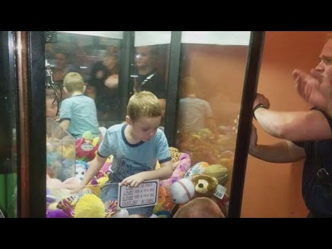 Boy gets suck in claw machine game trying to get a stuffed animal