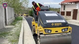 Continuă lucrările de asfaltare din comuna Lumina