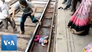 Indian Baby Survives Being Run Over by Train