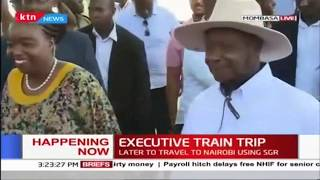 President Uhuru and President Museveni board the SGR