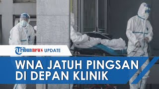 Tim Medis Berpakaian APD Evakuasi WNA yang Jatuh Pingsan di Depan Klinik Tebet, Jakarta Selatan