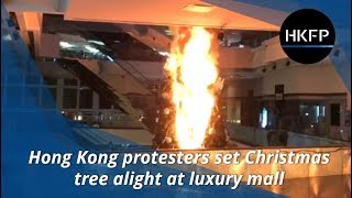 Hong Kong protesters set Christmas tree on fire at luxury mall