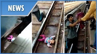 Moment miracle baby lives after falling onto tracks and under a moving train in India