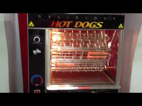 Maquina carrusel para asar salchichas con calentador de pan