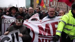 Belgium: Far-right activists rally against Merkel receiving honourary doctorate