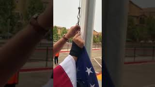 Steps in attaching the flag to a flag pole