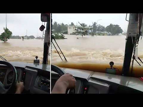 Bus Drives Through Flooded Road After Typhoon Nakri