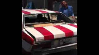 preview picture of video 'American flag painted car in Misratah Libya'