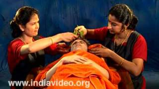 Netradhara - pouring of herbal extracts over the eyes
