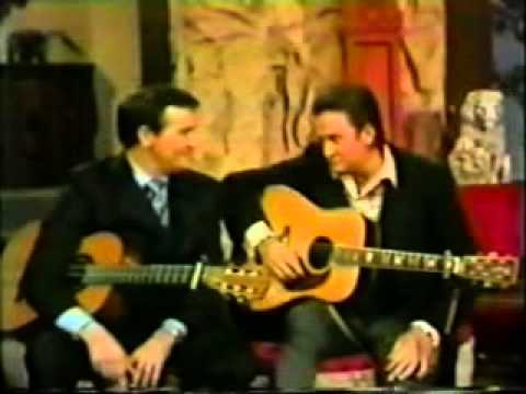 King of the Road performed by Johnny Cash and Roger Miller