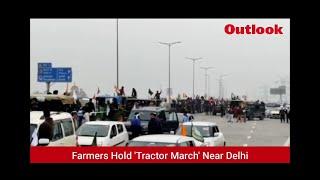 Farmers Hold 'Tractor March' Near Delhi
