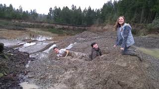 Kids playing in quick sand (mud)