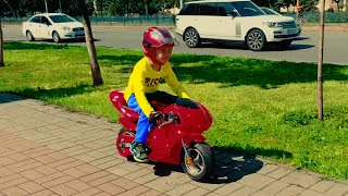 Kid Ride on Power Sport Bike to Toys Store for children choose a gift for friend birthday.