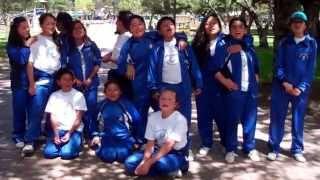 school children sing national anthem of Ecuador