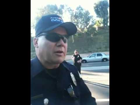 Berserk Cop Arrests Photographer For Standing On Footpath