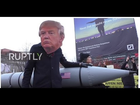 Germany: 'Trump' and 'Kim' face-off at anti-nuclear weapon human-chain demo
