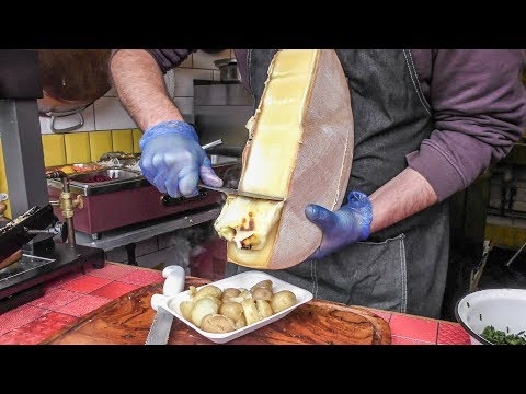 Yummy Swiss Raclette. Warm Melted Swiss Cheese with Egg and Potatoes. London Street Food