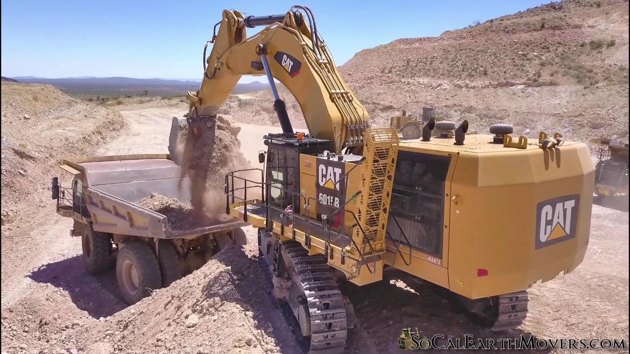 CAT 6015B Excavator Loading 100 Ton Haul Trucks