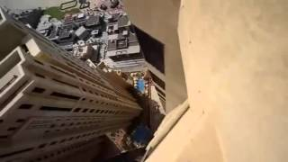 This guy has a death wish jumping around 100 stories in the air