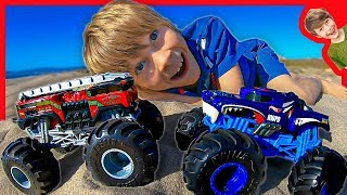 HOT WHEELS MONSTER TRUCKS AT THE BEACH WITH AXEL AND DADDY!