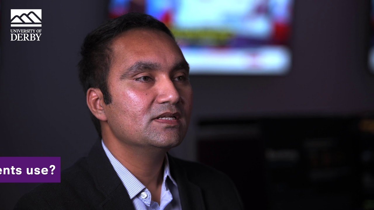 Dr Medhi Hassan, Senior Lecturer in International Business, talking to camera.