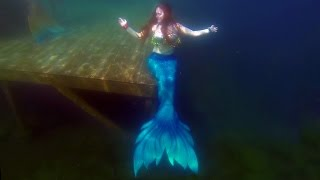 Mermaid Iona swims in a Finfolk Productions silicone mermaid tail