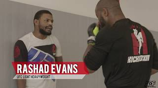 Rashad Evans coaches a frustrated Michael Johnson with his ground game