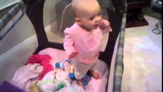One-year-old talks her way out of a nap