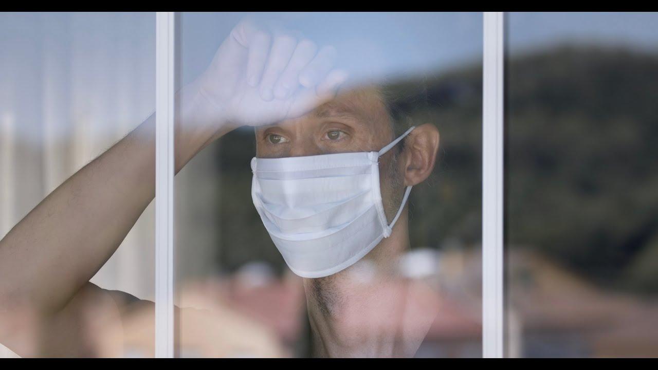 Man looks throught he window