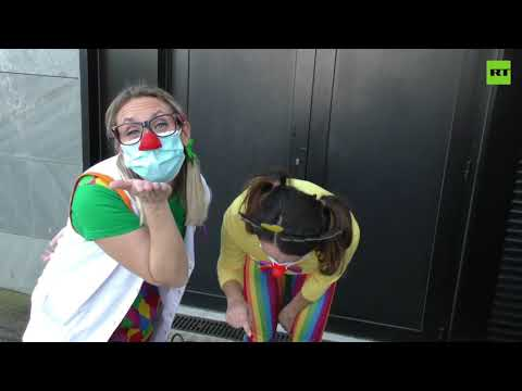 Spanish kids getting COVID test cheered by clowns