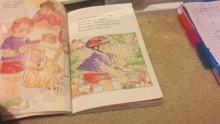 My 8 years old daughter reading a book