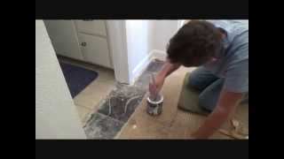 Applying a 2nd coat of paint to baseboards