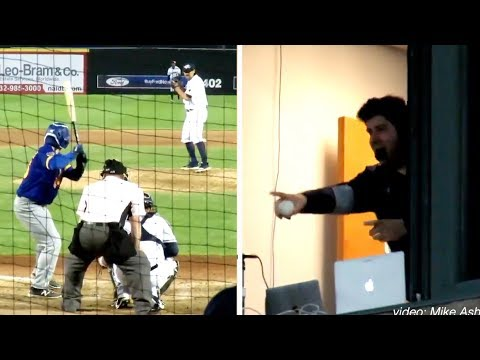 The announcer catches the foul ball while on call