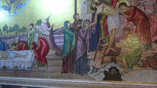 A mosaic depiction of Christ body being prepared after his death opposite the Stone of Anointing
