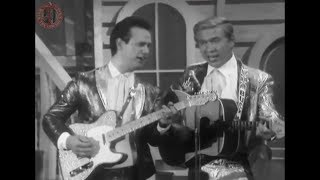 Buck Owens And His Buckaroos - I've Got A Tiger By The Tail