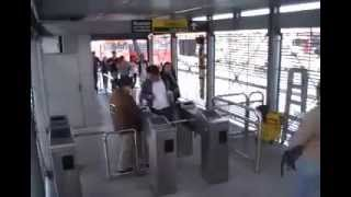 Man Trips Rude Woman at Train Station