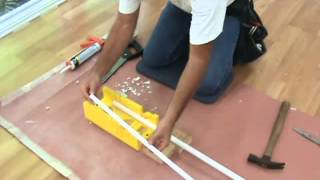 Cutting quarter round trim for a laminate floor