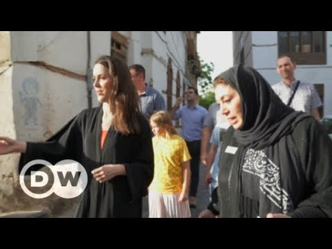 Wine from the Gobi Desert, Church asylum in Germany and a tourist guide to Saudi Arabia | DW English