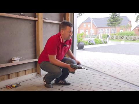 Montering af garageport bagmonteret fjedrer