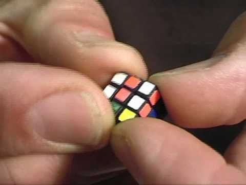 Solving The Smallest Rubik's Cube In The World