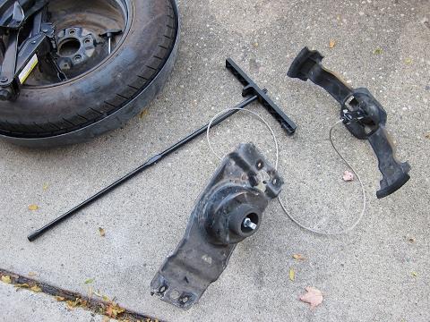 how to change tire on 2013 dodge caravan