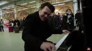 Random guy plays public piano. Crowd goes mental!