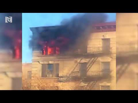 Fire engulfs top floor of Manhattan apartment building