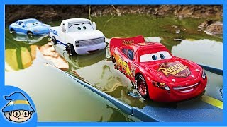 Disney Lightning McQueen car and school bus Miss Fritter is on the road.