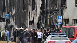 Italy: 'Eight killed' as light plane crashes into empty office building in Milan suburb