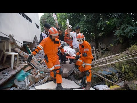 Indonesia appeals for help amid race to reach quake survivors