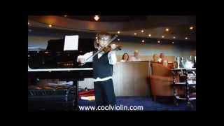 Peleg performing with his violin on the Oosterdam cruise ship May 20, 2013