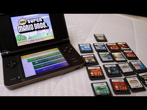Nintendo DSi XL with original games, charger and case