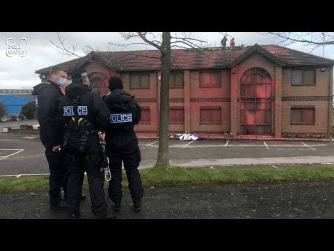 Two arrested after dousing military factory in red paint