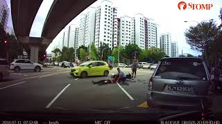 Biker and pillion rider hit by car in Punggol shows why beating the red light never ends well